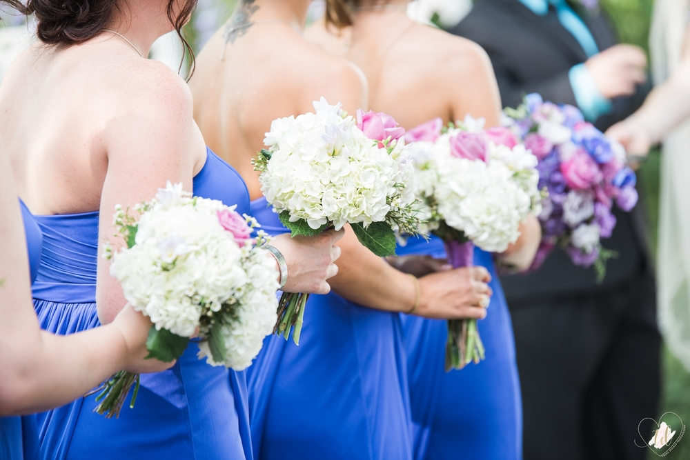 Bridesmaids bouquets during Maine wedding ceremony.