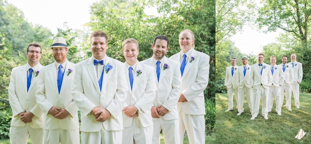 Groom and Groomsmen in white suits with blue indigo vests and ties with purple boutineers.