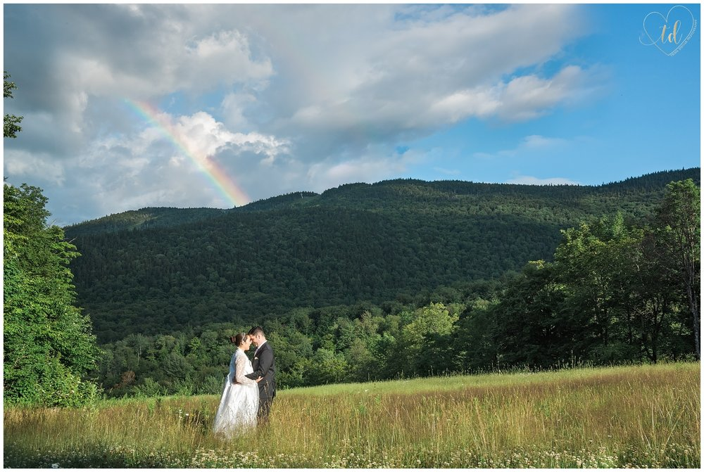 Sunday River Wedding Photographer captures bride and groom portraits overlooking mountains.