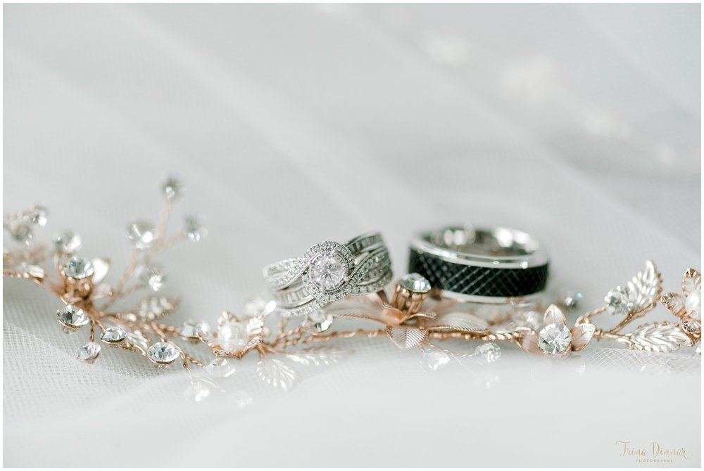 Maine wedding bands and engagement ring on bride's veil.
