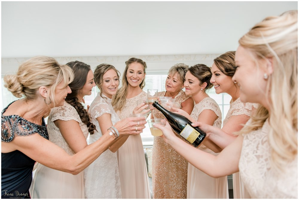 Bride shares toast with moms and bridesmaids