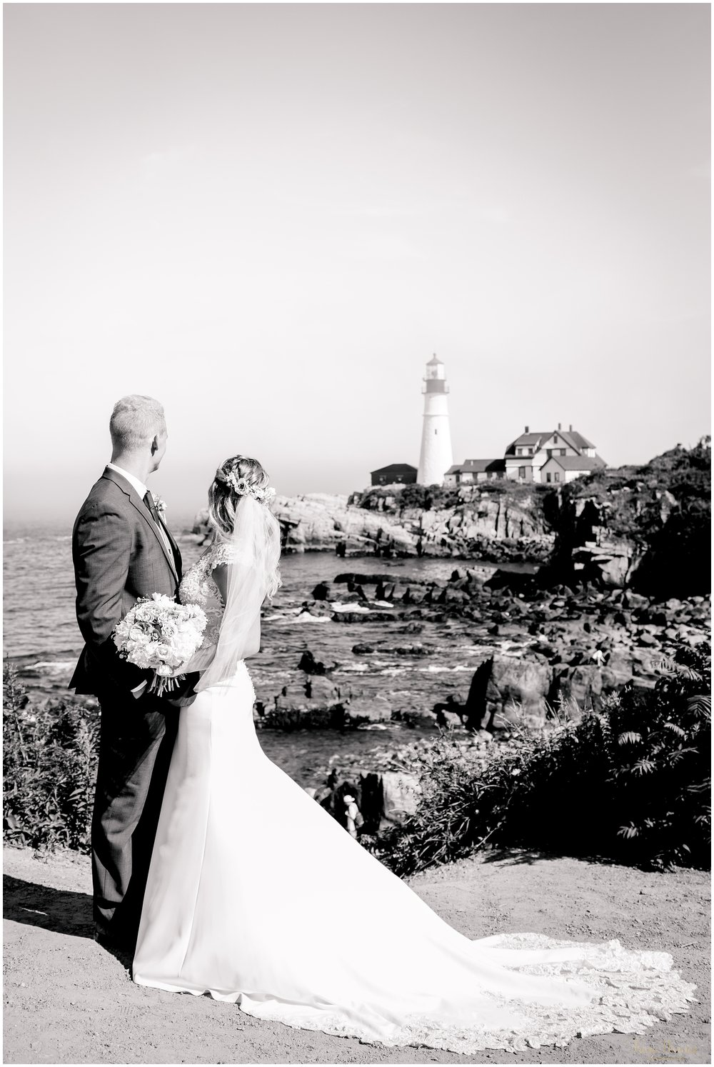 Cape Elizabeth Maine Wedding Scene with Bride and Groom looking at Portland Headlight