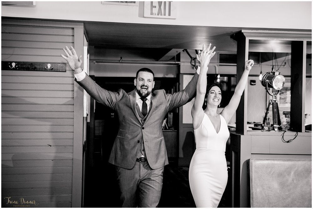 Excited Bride and Groom Enter their Wedding Reception at RiRa in Portland Maine