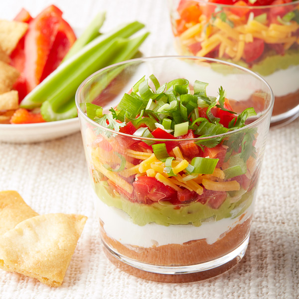 I'd consider these Mini Mexican 7 Layer Dips a party must-have!  They stay pretty and allow for double-dipping with wanton abandon. Even better? This one is a Weight Watchers recipe so it's sneaky-light too...shhhh!