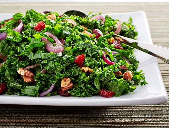 Cider Braised Kale Ribbons with Cranberries & Walnuts:  A delicious cross between salad and saute, the sweet-tart cranberries & crunch of toasted walnuts give this gorgeous dish major crowd appeal!