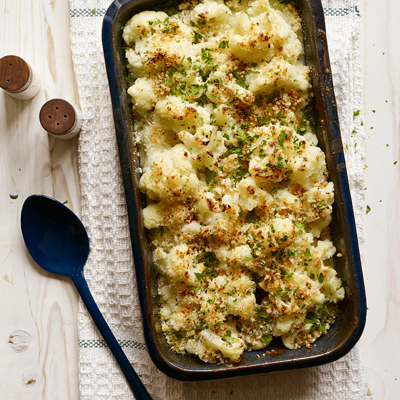 Cheesy Cauliflower Gratin with Crunchy Panko Topping:  A mix of cheeses is the secret to this dish's decadent-seeming cheese sauce.  Pecorino cheese & panko breadcrumbs work magic together as a crispy topping.