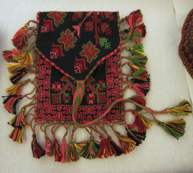 Traditional gift from a woman to her betrothed: an embroidered pouch to keep his tobacco and rolling papers.