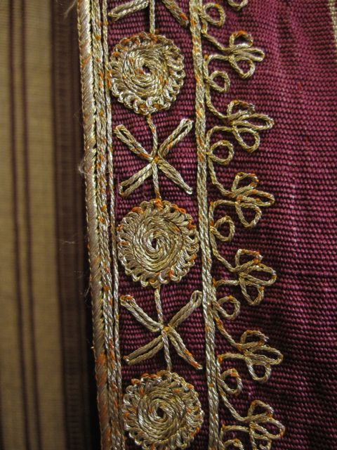Metal thread embroidery detail on a Syrian silk abaya from the 19th century, at Tiraz.