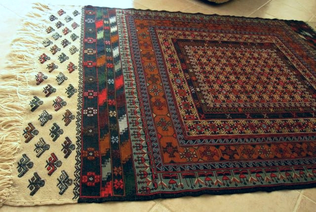 Soumak rug, purchased from Dagestani pilgrims on their way to Mecca, in Damascus in 2010. The pilgrims bring a large load of rugs to sell, in order to finance their pilgrimage. A friend was in Damascus at the time, and offered to get a rug for me.