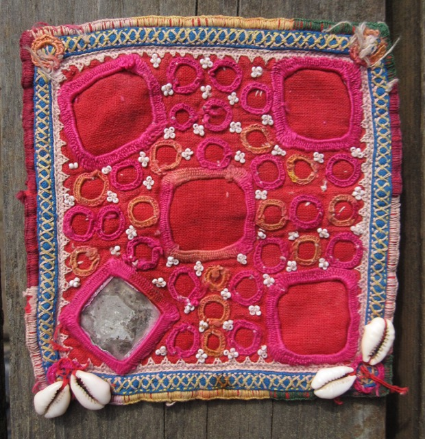 Intact small embroidered and beaded piece from Gujarat, India.