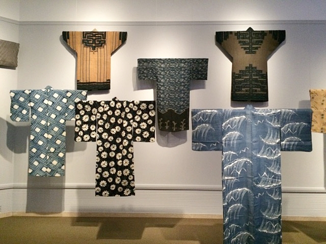A roomful of kimono at the Mood Indigo exhibit. The two uppermost are from the Ainu people, indigenous residents of Hokkaido (my favorite designs.)