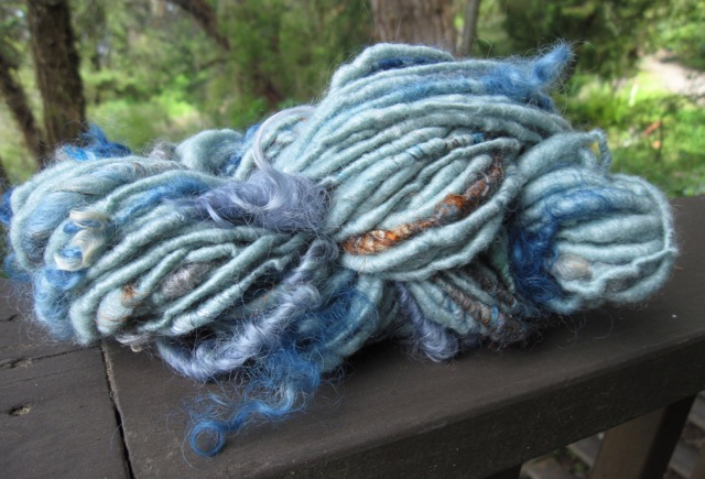 Corespun merino silk with indigo locks and silk waste