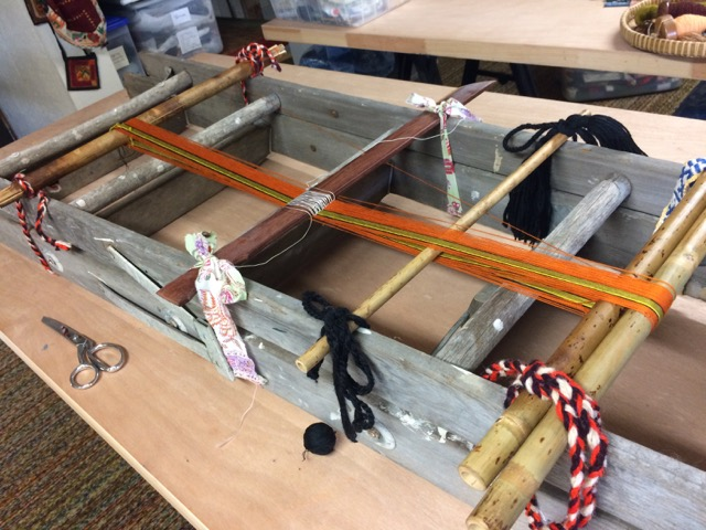 Making a warp using a ladder as frame, in my own studio.