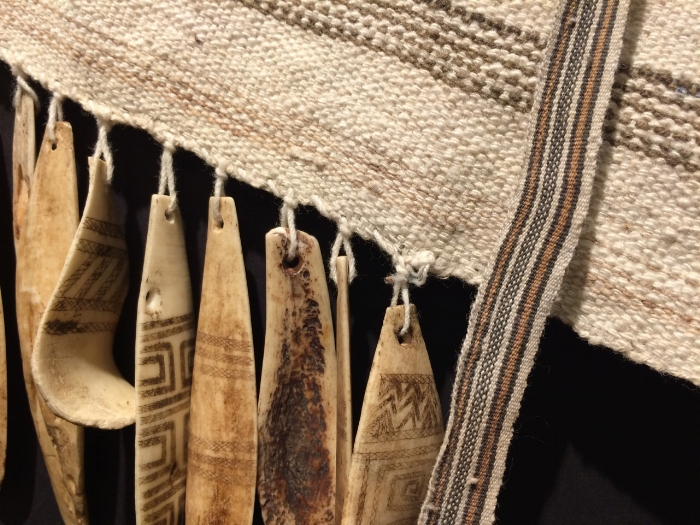 Detail of bone tassels and bag strap, handwoven cotton.