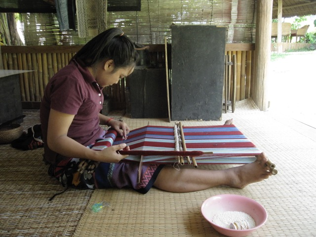 My friend Keo, a Katu weaver from Salavan province, weaves on a loom with parts just like the ones excavated in Shizhaishan, China. My photo from 2013, Ock Pop Tok Living Crafts Center, Luang Prabang, Laos