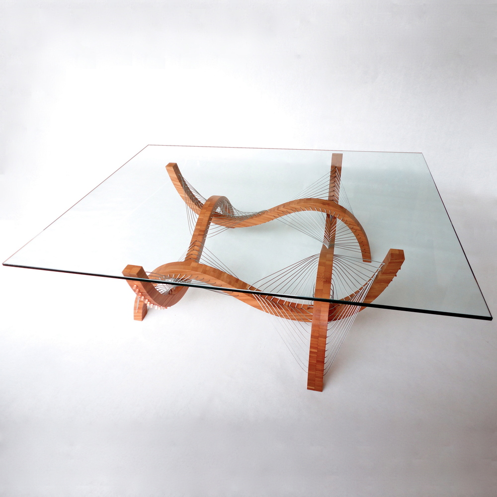 "Contour Coffee table by robby cuthbert. A modern, sculptural, architecturally-inspired coffee table made with plyboo bamboo and wire. The base is held together by steel cable under tension and a piece of glass is placed on top to serve as the tabletop.                                 0     false             18 pt     18 pt     0     0         false     false     false                                                     /* Style Definitions */ table.MsoNormalTable 	{mso-style-name:""Table Normal""; 	mso-tstyle-rowband-size:0; 	mso-tstyle-colband-size:0; 	mso-style-noshow:yes; 	mso-style-parent:""""; 	mso-padding-alt:0in 5.4pt 0in 5.4pt; 	mso-para-margin:0in; 	mso-para-margin-bottom:.0001pt; 	mso-pagination:widow-orphan; 	font-size:12.0pt; 	font-family:""Times New Roman""; 	mso-ascii-font-family:Cambria; 	mso-ascii-theme-font:minor-latin; 	mso-fareast-font-family:""Times New Roman""; 	mso-fareast-theme-font:minor-fareast; 	mso-hansi-font-family:Cambria; 	mso-hansi-theme-font:minor-latin;}"