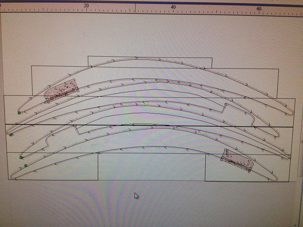 Planning out the placement of the four curves and mahogany boards in the CNC program VCarve, I was able to determine the most economical use of wood I was using.