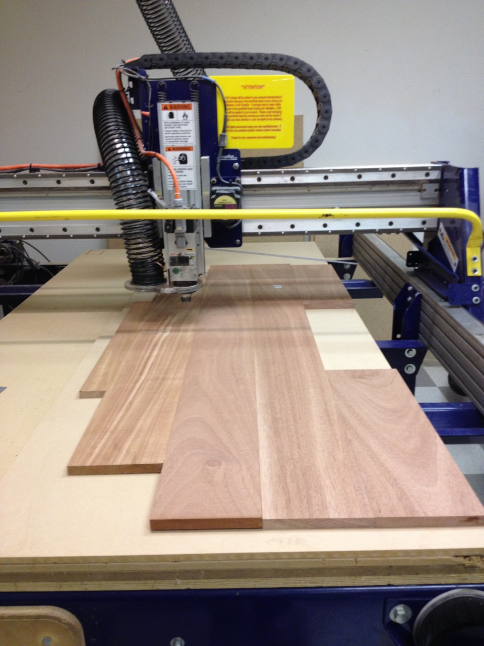 Having visualized the placement of the mahogany in VCarve, I was able to precisely place the boards on the Shopbot.