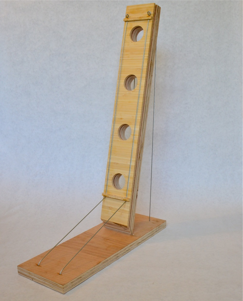 The initial plywood prototype had a wider base than the final version.