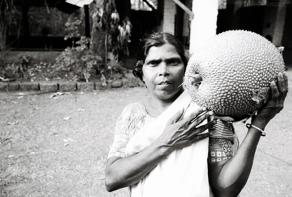 Lakshmi holding Jackfruit at Karipal Mana
