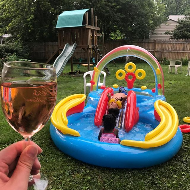 Now THIS is how you summer.  #happykids #bestinflatable #backyardbliss  #rosetime🍷  #photoaday2018