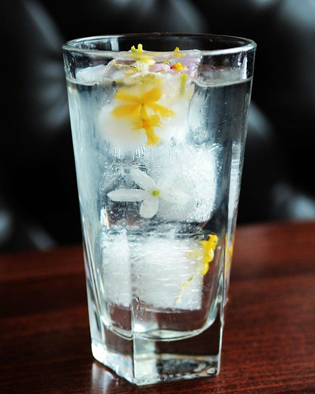 """Isn't this SO PRETTY?! We've captured our feelings about this """"Spring"""" in a glass... we're waiting on the ice to melt for beautiful spring flowers, too! Introducing the Petal Party - Sauza Tequila, Tattersall Distilling grapefruit creama, dry vermouth, rose water, orange flower water. 🌸🌼🌺"""