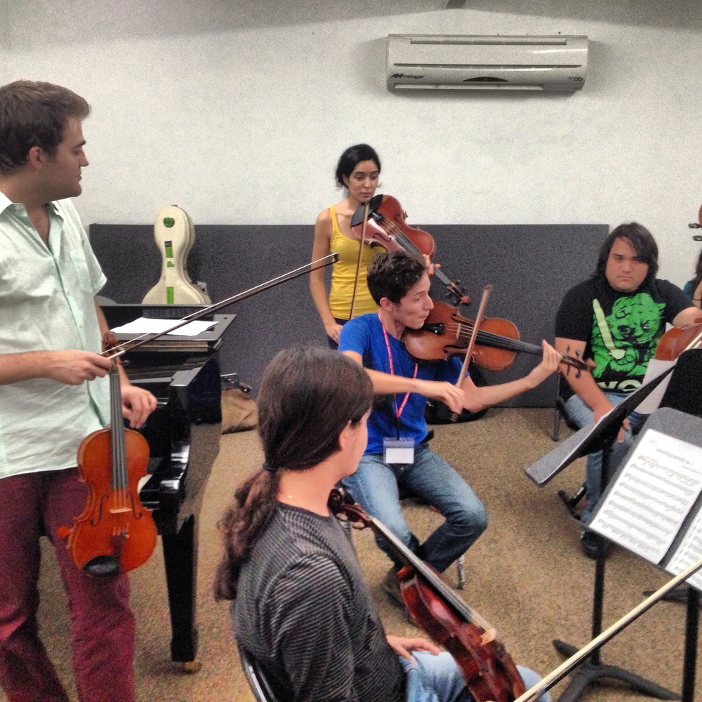 Meena coaches violist, Roberto, in Borodin Quartet during an open chamber music master class at ESAY