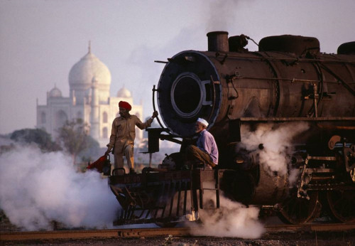 Two men on steam train in India. <http://www.smashingmagazine.com/2010/03/20/the-beauty-of-india-50-amazing-photos/>