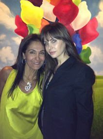 Olya Kislin and designer Farah Amin at Henry Buehls home for a private art auction for Ace Charity
