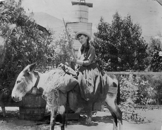 Lou Henry on a burro, age 17.