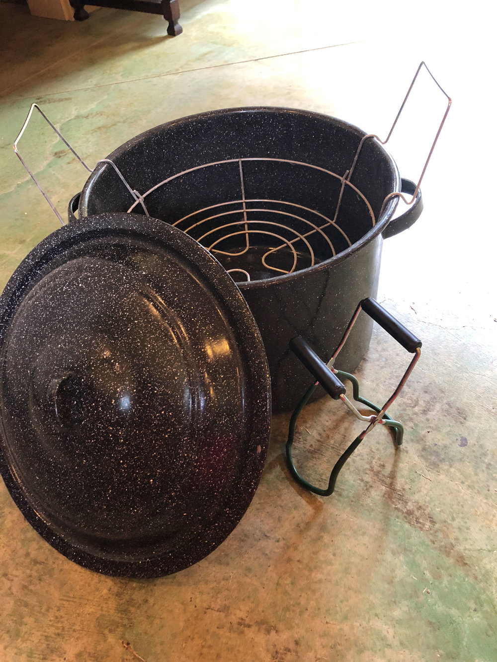 Canning pot with lid and rack; jar grippers.