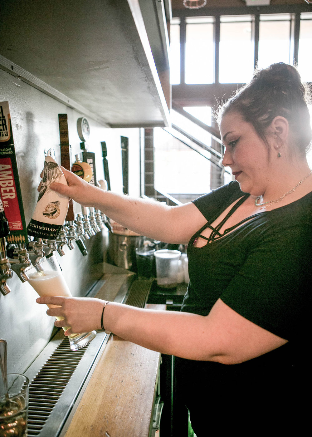 Pouring beer from a tap at Cultivo Restaurant in Ukiah, CA