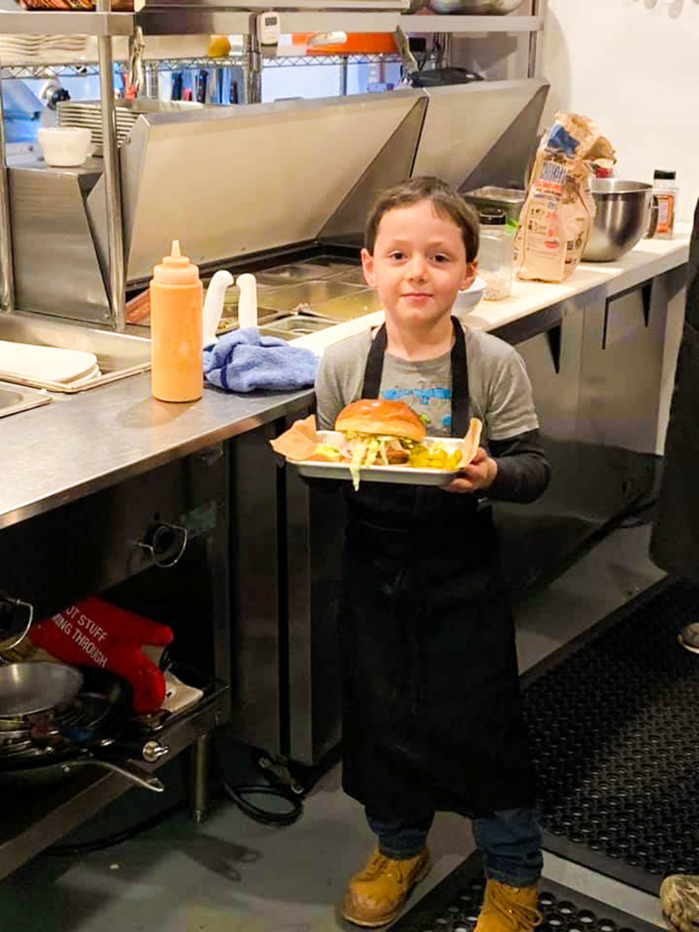 John and Regine's son, Sam, helps in the kitchen