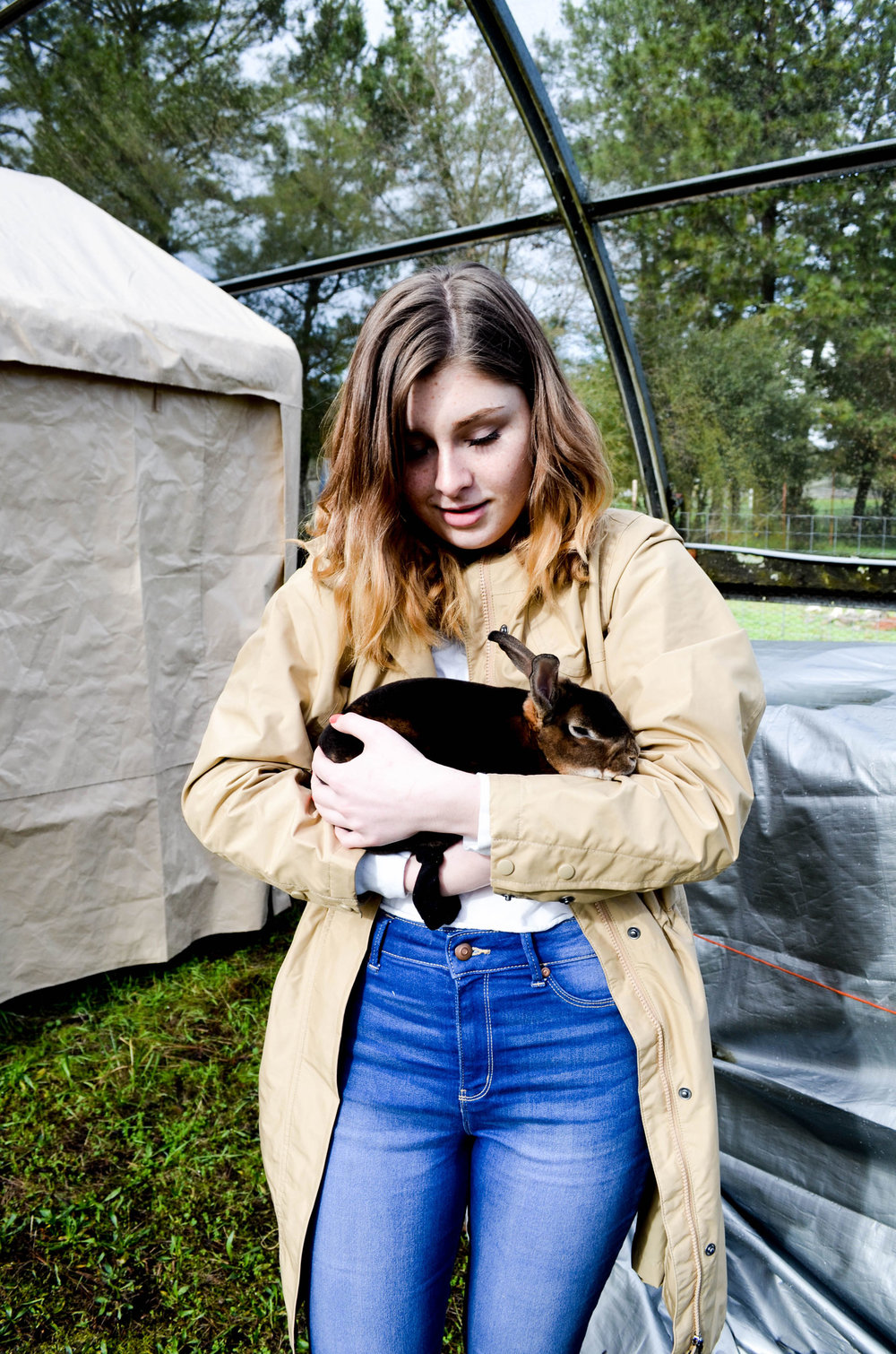 Student Claire holds a rabbit.