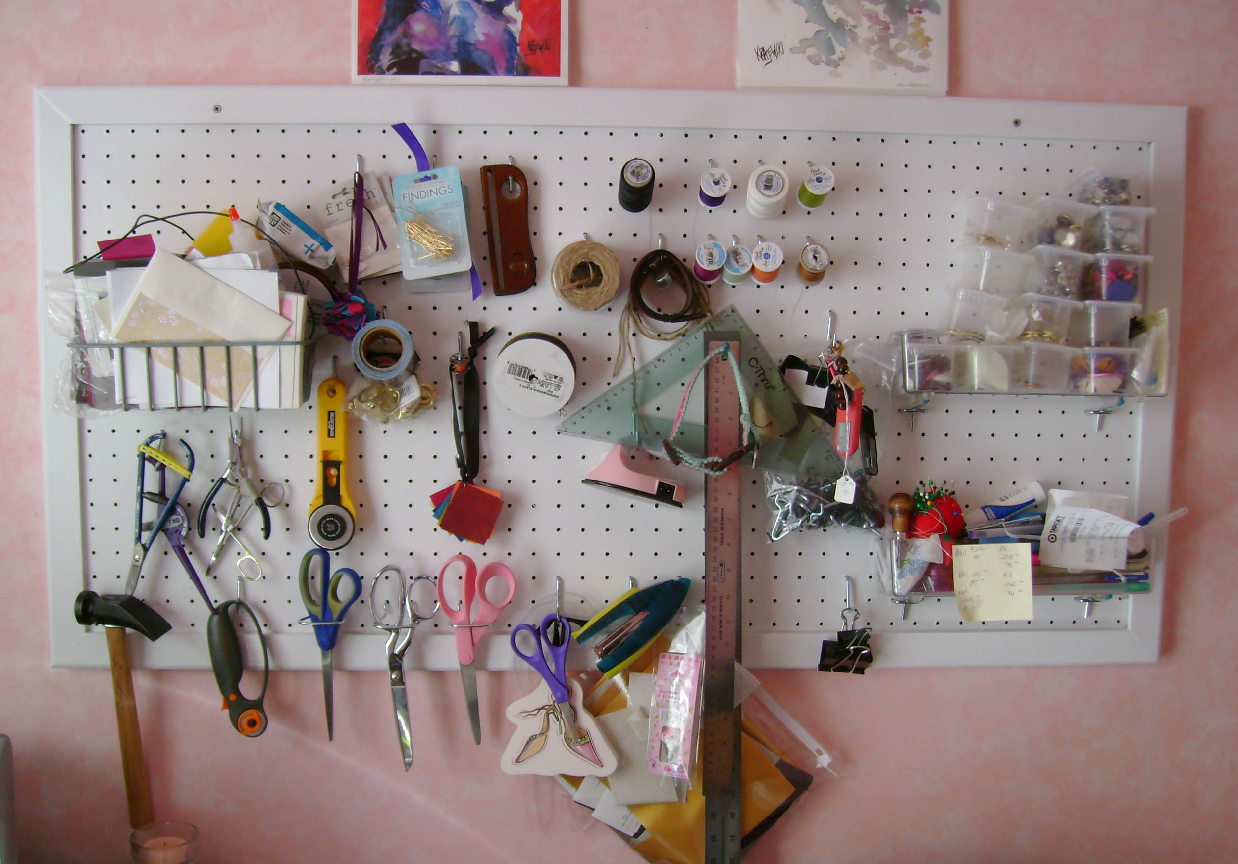 Another shot of her workspace. The pegboard is a great way to keep crafting tools organized.