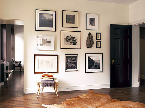 A gallery wall in the entry (by Nate Berkus, of course)