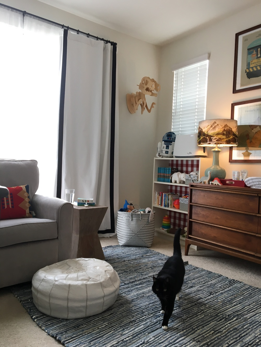 We reused the shelves, curtains, and pouf from when this room was my office.