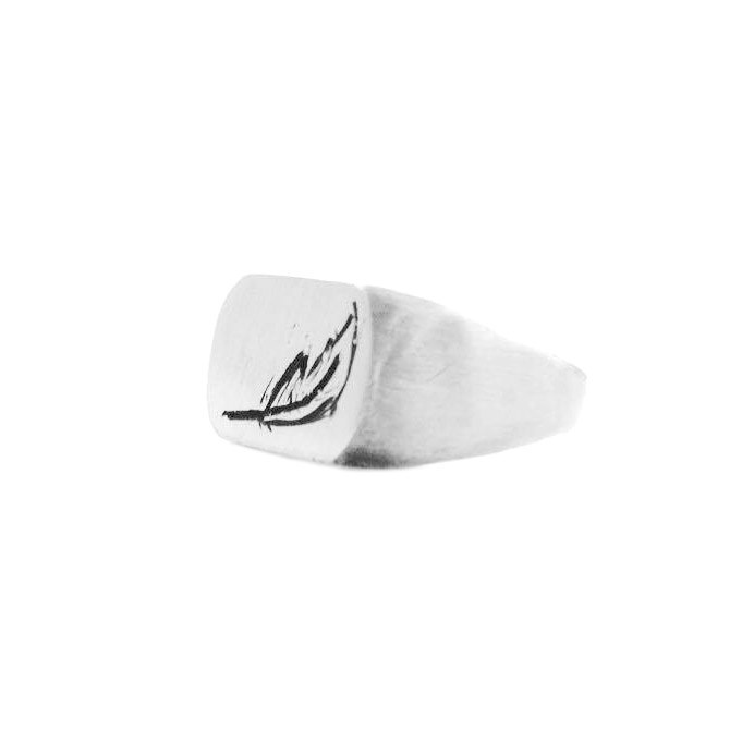 Sterling silver.     Matte finish signet ring with a hand engraved feather. Client chose from a variety of different symbols before deciding on this one. Made for her boyfriend who misses his birds he left in behind in Paris.