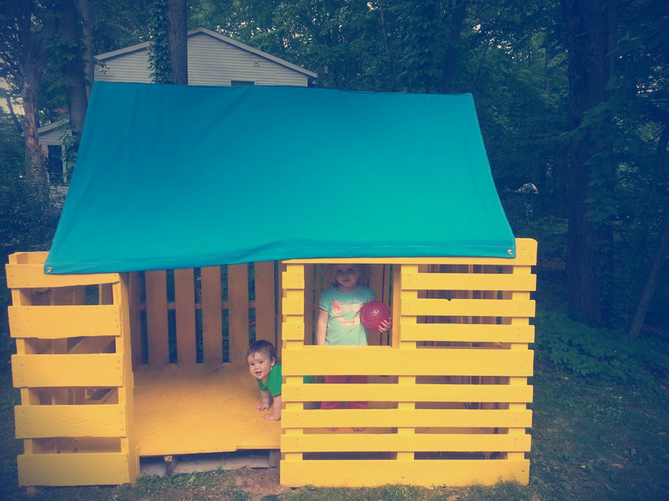Claire and Noah, enjoying the new pallet playhouse.