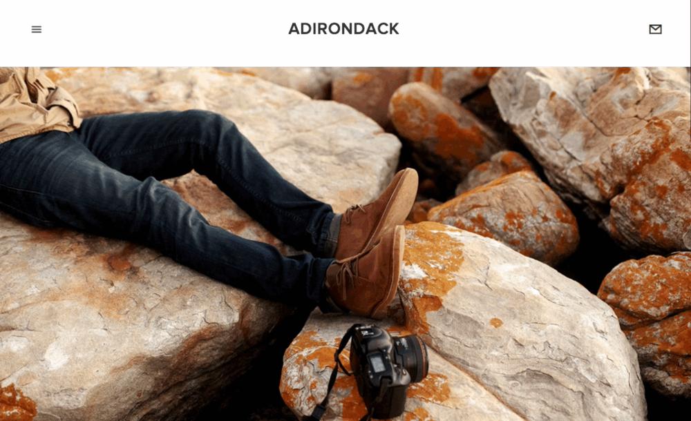Adirondack is het perfecte template voor zelf-beginners en kundige ondernemers. Zijn minimale navigatie en de volle kopafbeeldingen bieden een gedurfd kader om je merk te tonen.
