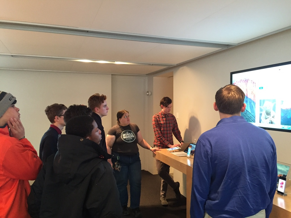 Mobile Makers Alumni Michelle Burke and Nathan Hosselton walk students through some code logic.