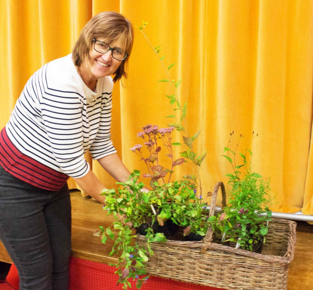Jill Cawthray with flowers good for attracting wildlife