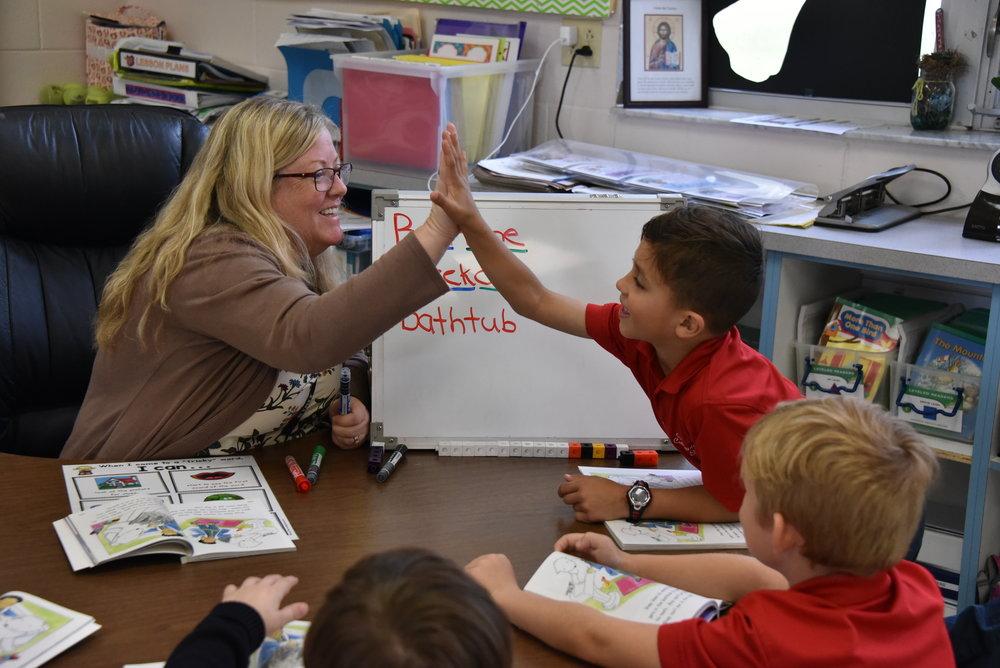 Mrs. Westner celebrating success with a student.