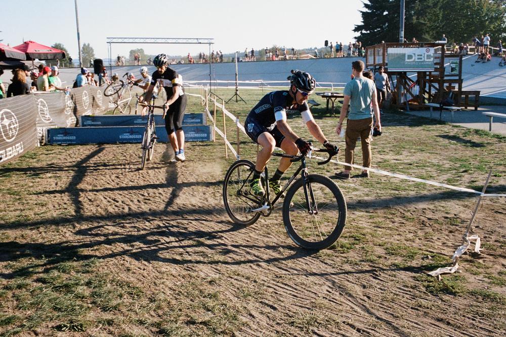 Ira Ryan and his Breadwinner CX bikethrough the barriers.