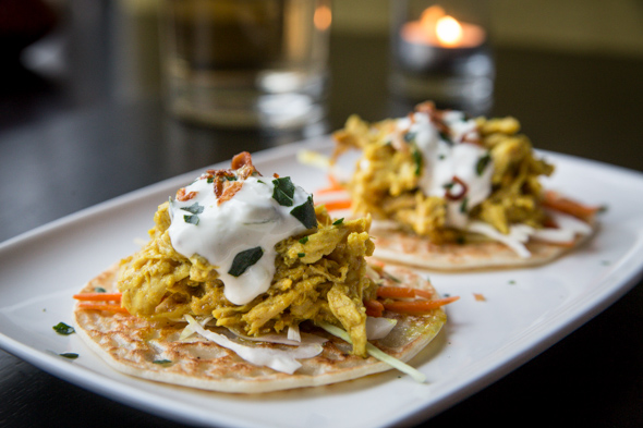 Pulled Kapitan Tacos   lemongrass and lime leaf braised chicken kapitan, house made 'taco', napa carrot slaw, johnny's tzatziki, fried shallots  photo credit: jesse milns