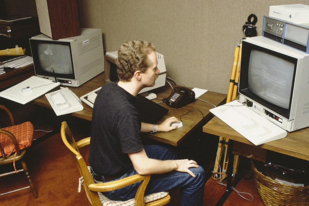 """Craig at work in the graphics room at LFL in the 1980s. """"I don't remember the occasion,"""" he said, """"but this was way before the Pixar Image Computer existed as hardware. The room is ... where, among other things, the Genesis Effect, 'The Adventures of André & Wally B.' and the stained glass knight from 'Young Sherlock Holmes' were produced."""" © Pixar Animation Studios. All rights reserved."""