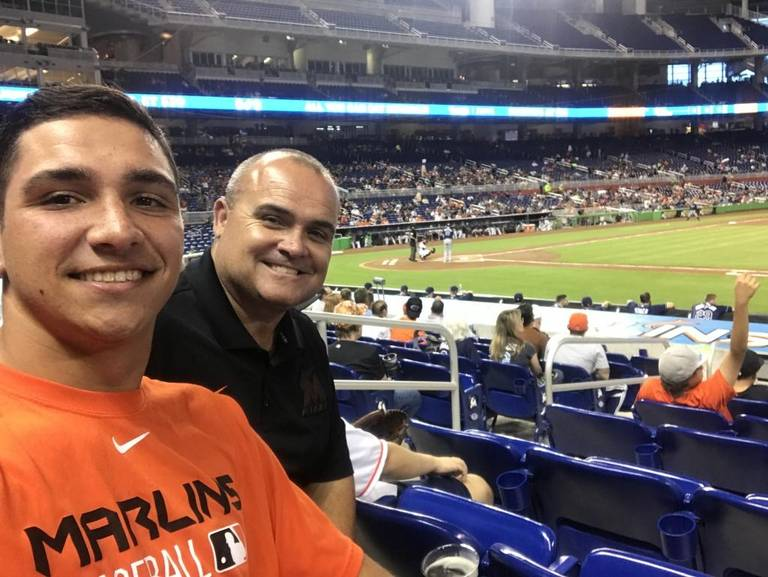Jake Anchia with his father at a Miami Marlins game. Photo from The Miami Herald.