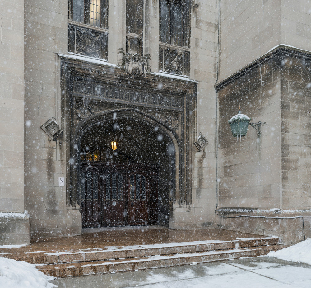 A massive panoramic image captures the Harper Memorial Library Gate as a tempestuous February snowstorm rolls through campus.  225 megapixels