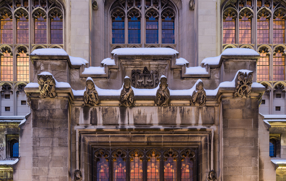 Stuart Hall and its Gargoyles, decorated in snow and illuminated by the light of a cold dawn.