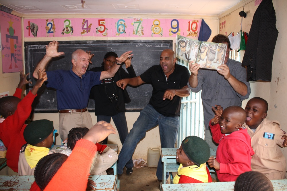 Bill Krupman (left) starting a wild rumpus with LitClub kids during a 2012 LitWorld trip to Kibera, Kenya.